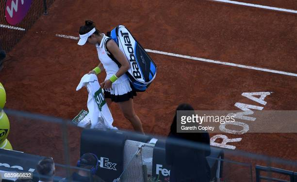 Garbine Muguruza of Spain leaves the court after retiring injuried during her semi final match against Elina Svitolina of Ukraine in The...