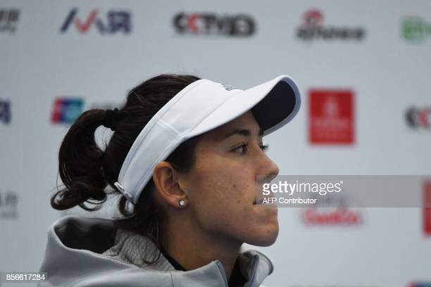 Garbine Muguruza of Spain listens to questions during a press conference after retiring from her women's singles match against Barbora Strycova of...