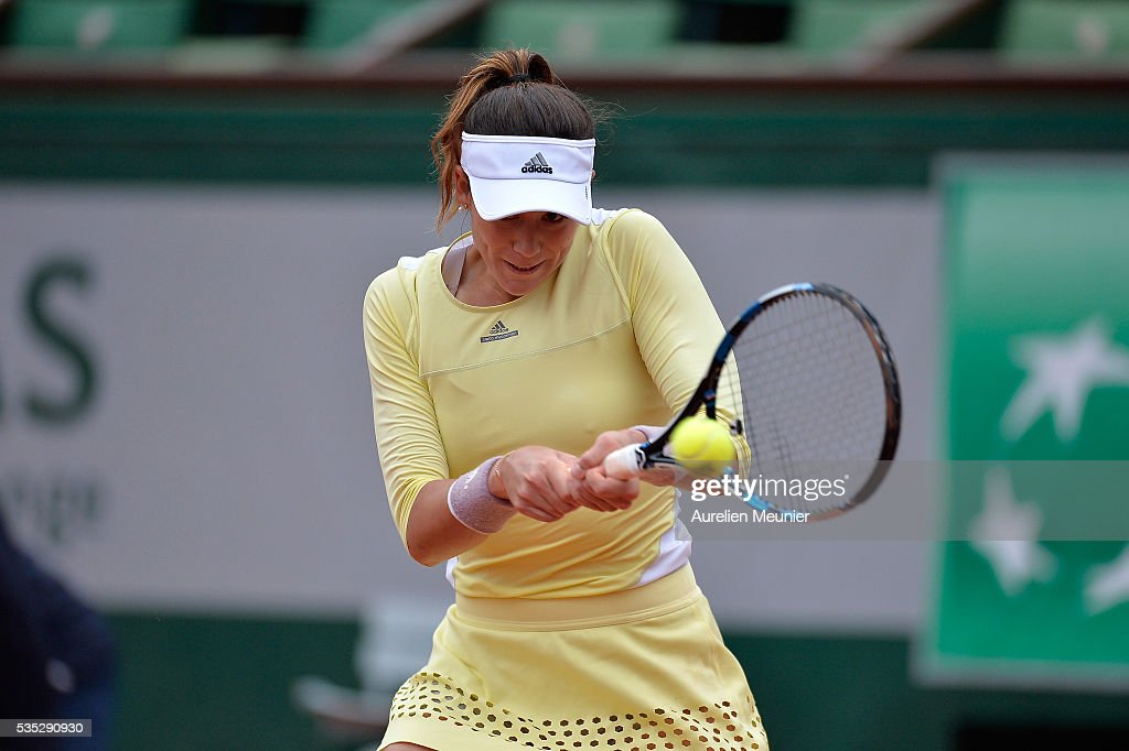 Garbine Muguruza of Spain plays a backhand during her women's singles fourth round match against Svelatana Kuznetsova of Russia on day eight of the 2016 French Open at Roland Garros on May 29, 2016 in Paris, France.