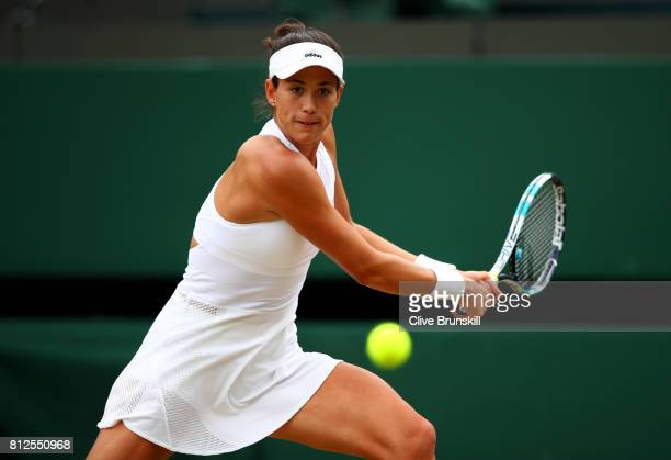 Garbine Muguruza of Spain plays a backhand during the Ladies Singles quarter final match against Svetlana Kuznetsova of Russia on day eight of the...
