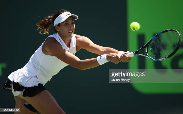 Garbine Muguruza of Spain plays a backhand in her match against Caroline Wozniacki of Denmark at Crandon Park Tennis Center on March 27 2017 in Key...