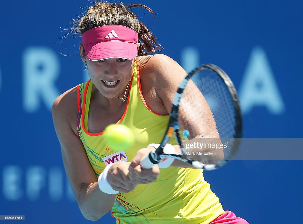 Garbine Muguruza of Spain plays a backhand in her qualifying singles match with Tammi Patterson of Australia during day two of the Hobart International at Domain Tennis Centre on January 5, 2013 in Hobart, Australia.