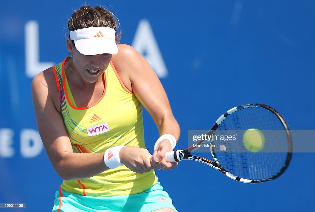 Garbine Muguruza of Spain plays a backhand in her qualifying singles match with Mandy Minella of Luxembourg during day three of the Hobart International at Domain Tennis Centre on January 6, 2013 in Hobart, Australia.