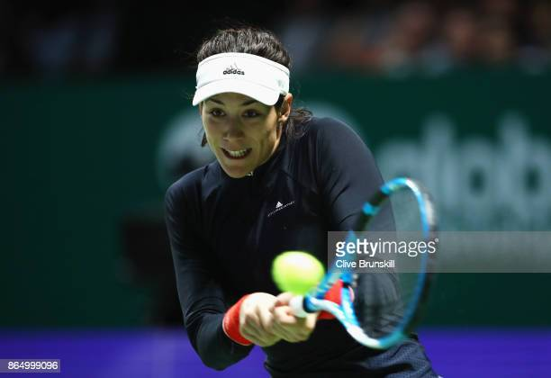 Garbine Muguruza of Spain plays a backhand in her singles match against Jelena Ostapenko of Latvia during day 1 of the BNP Paribas WTA Finals...
