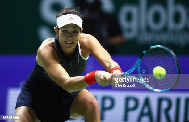 Garbine Muguruza of Spain plays a backhand in her singles match against Venus Williams of the United States during day 5 of the BNP Paribas WTA...