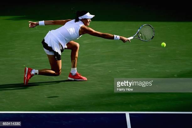 Garbine Muguruza of Spain plays a backhand in her win over Elina Svitolina of Ukraine during the BNP Paribas Open at Indian Wells Tennis Garden on...