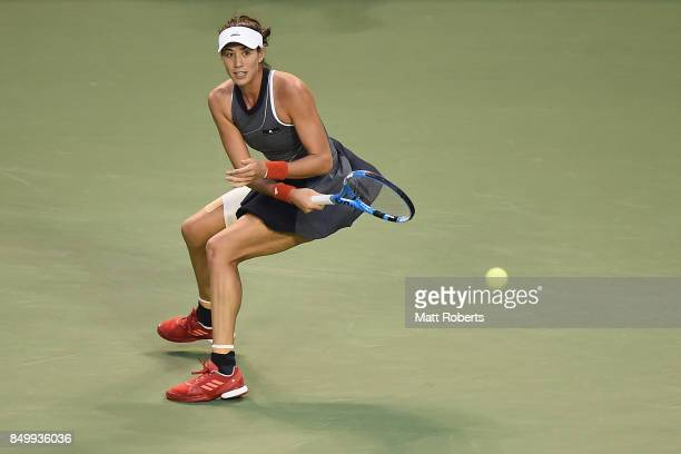 Garbine Muguruza of Spain plays a forehand against Monica Puig of Puerto Rico during day three of the Toray Pan Pacific Open Tennis At Ariake...