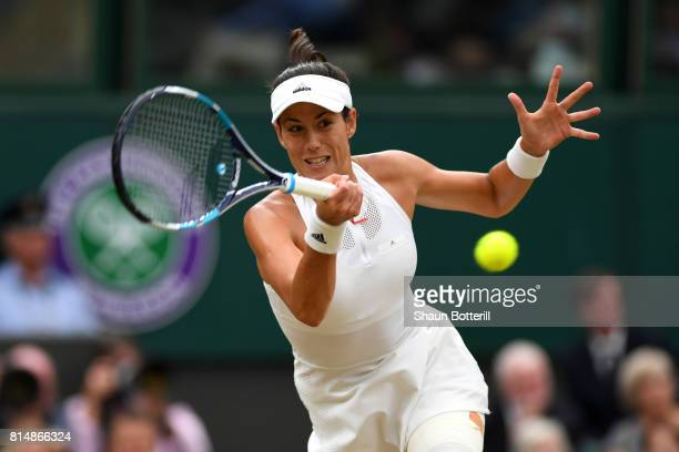 Garbine Muguruza of Spain plays a forehand during the Ladies Singles final against Venus Williams of The United States on day twelve of the Wimbledon...