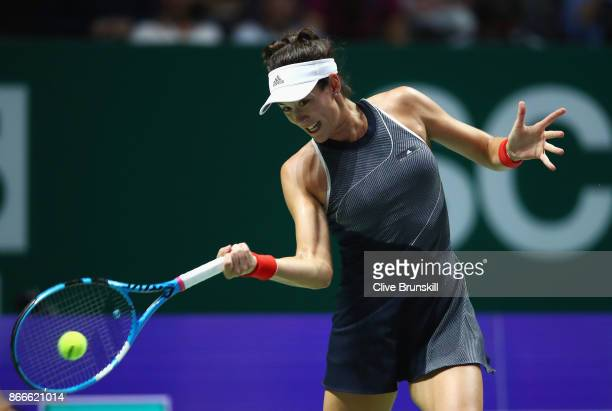 Garbine Muguruza of Spain plays a forehand in her singles match against Venus Williams of the United States during day 5 of the BNP Paribas WTA...