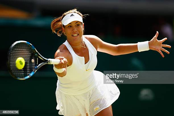 Garbine Muguruza of Spain plays a forehand in the Final Of The Ladies' Singles against Serena Williams of the United States during day twelve of the...