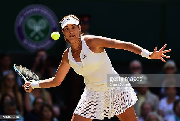 Garbine Muguruza of Spain plays a forehand in the Ladies Singles Semi Final match against Agnieszka Radwanska of Poland during day ten of the...
