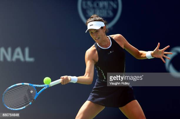 Garbine Muguruza of Spain plays a shot against Elina Svitolina of Ukraine during a quarterfinal match on Day 8 of the Rogers Cup at Aviva Centre on...
