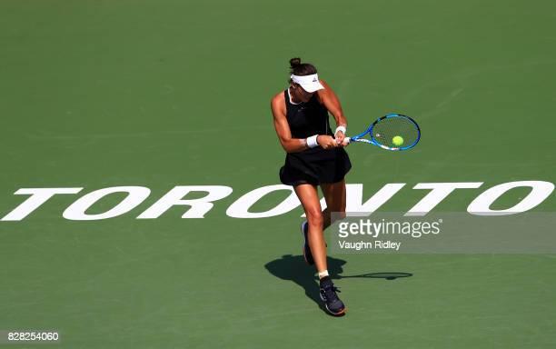 Garbine Muguruza of Spain plays a shot against Kirsten Flipkens of Belgium during Day 5 of the Rogers Cup at Aviva Centre on August 9 2017 in Toronto...