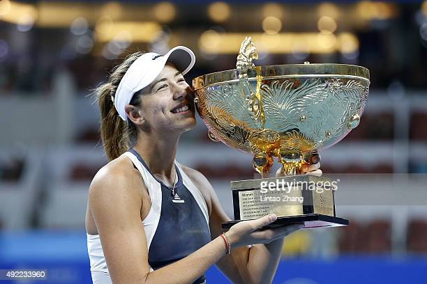 Garbine Muguruza of Spain poses with her trophies during the medal ceremony after the Women's Single Final match against Timea Bacsinszky of...