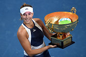 Garbine Muguruza of Spain poses with her trophy during the medal ceremony after the Women's Single Final match against Timea Bacsinszky of...