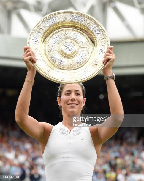 Garbine Muguruza of Spain poses with The Venus Rosewater Dish after winning the Ladies Singles final against Venus Williams of The United States on...
