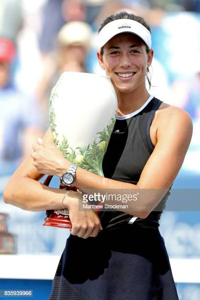 Garbine Muguruza of Spain poses with the winner's trophy after defeating Simona Halep of Romania during the women's final on day 9 of the Western...