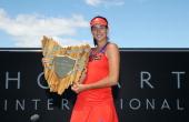 Garbine Muguruza of Spain poses with the winners trophy after victory in her singles final match against Klara Zakopalova of the Czech Republic...