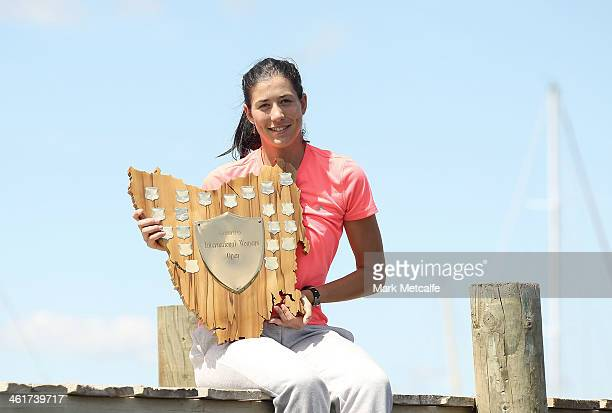 Garbine Muguruza of Spain poses with the winners trophy on a visit to Battery Point after victory in the Women's singles final match against Klara...