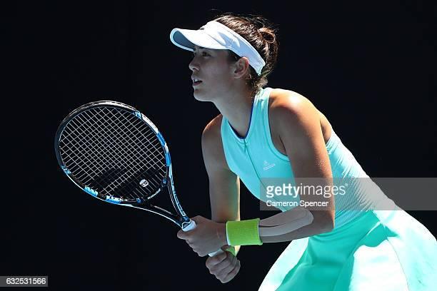 Garbine Muguruza of Spain prepares to return serve in her quarterfinal match against CoCo Vandeweghe of the United States on day nine of the 2017...