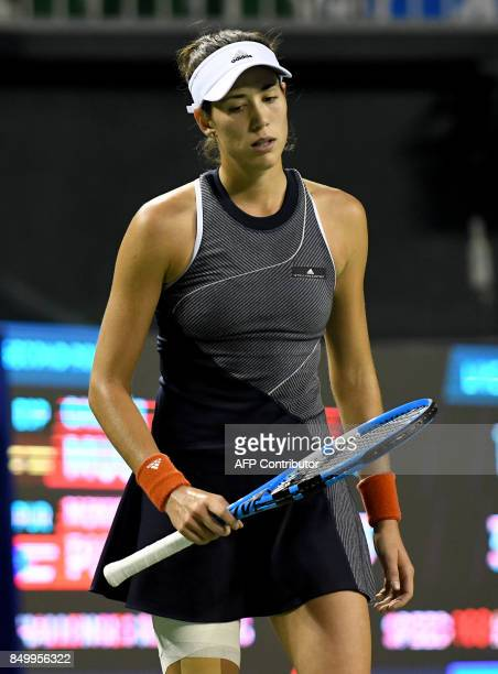 Garbine Muguruza of Spain reacts after losing a point against Monica Puig of Puerto Rico during their women's singles second round match at the Pan...