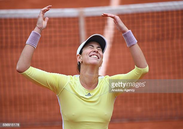 Garbine Muguruza of Spain reacts after winning the women's single quarter final match against Shelby Rogers of US at the French Open tennis...