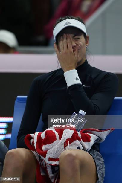 Garbine Muguruza of Spain reacts before retiring due injury during the match against Barbora Strycova of Czech Republic on day three of the 2017...