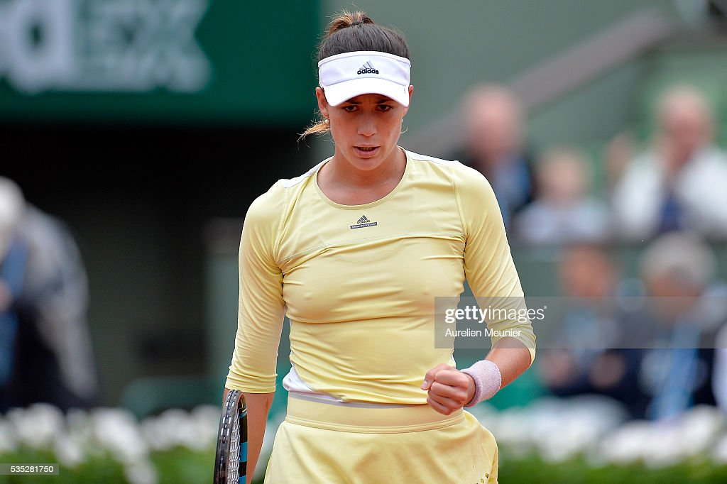 Garbine Muguruza of Spain reacts during her women's singles fourth round match against Svelatana Kuznetsova of Russia on day eight of the 2016 French Open at Roland Garros on May 29, 2016 in Paris, France.