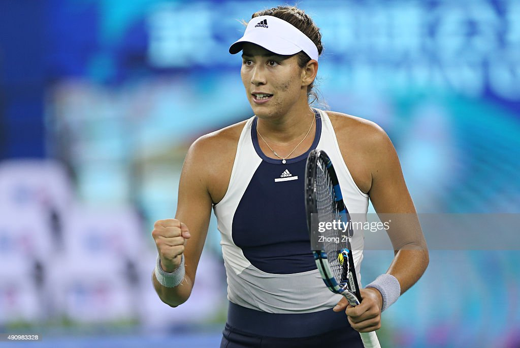 Garbine Muguruza of Spain reacts during the semifinal match against Angelique Kerber of Germany on Day 6 of 2015 Dongfeng Motor Wuhan Open at Optics...