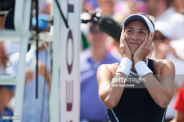 Garbine Muguruza of Spain reacts to winning the ladies finals match against Simona Halep of Romania after in the Western Southern Open at the Lindner...