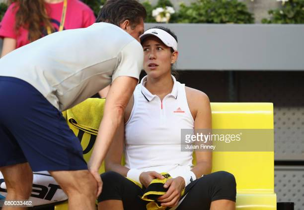 Garbine Muguruza of Spain receives coaching by Sam Sumyk in her match against Timea Bacsinszky of Switzerland during day two of the Mutua Madrid Open...