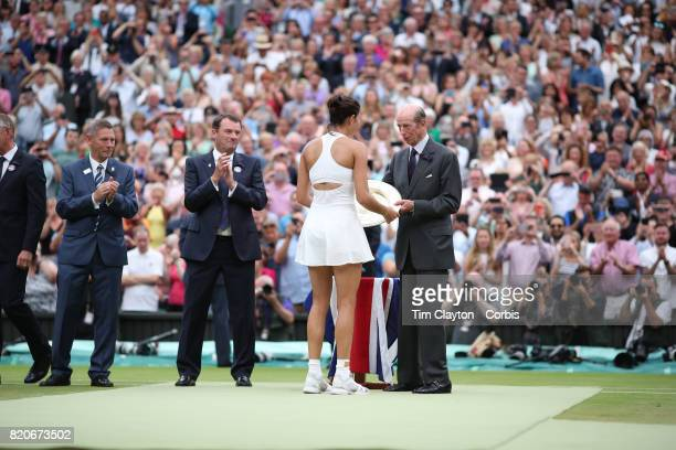 Garbine Muguruza of Spain receives her winners trophy from Prince Edward Duke of Kent after her victory against Venus Williams of The United States...