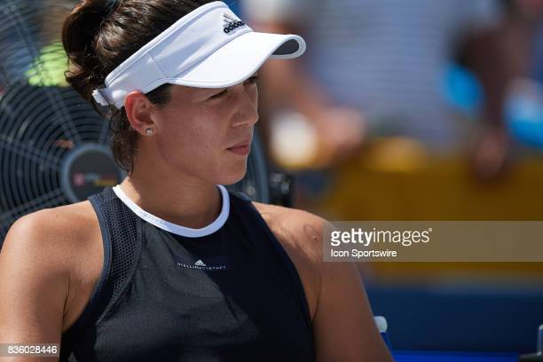 Garbine Muguruza of Spain reflects on winning the ladies finals match against Simona Halep of Romania after in the Western Southern Open at the...