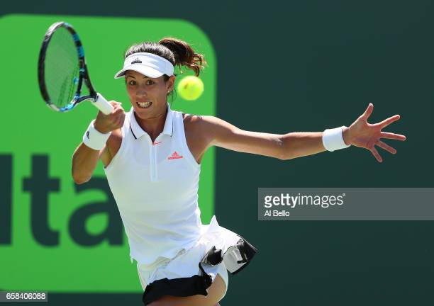 Garbine Muguruza of Spain returns a shot against Caroline Wosniacki of Denmark during Day 8 of the Miami Open at Crandon Park Tennis Center on March...