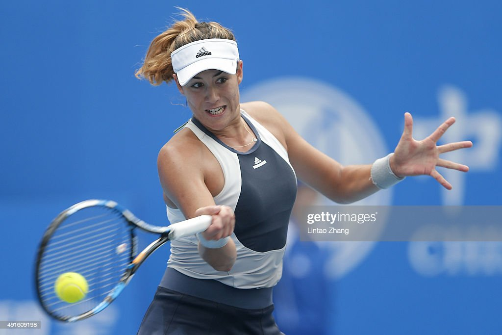 Garbine Muguruza of Spain returns a shot against Irina Falconi of the United States during the Women's singles Second round match on day five of the 2015 China Open at the China National Tennis Centre on October 6, 2015 in Beijing, China.