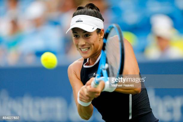 Garbine Muguruza of Spain returns a shot against Madison Keys of the United States during Day 6 of the Western and Southern Open at the Lindner...