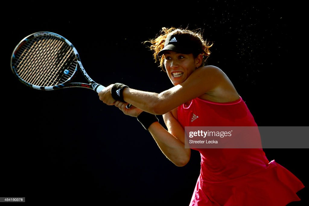 Garbine Muguruza of Spain returns a shot against Mirjana Lucic-Baroni of Croatia during her women's singles first round match on Day One of the 2014 US Open at the USTA Billie Jean King National Tennis Center on August 25, 2014 in the Flushing neighborhood of the Queens borough of New York City.