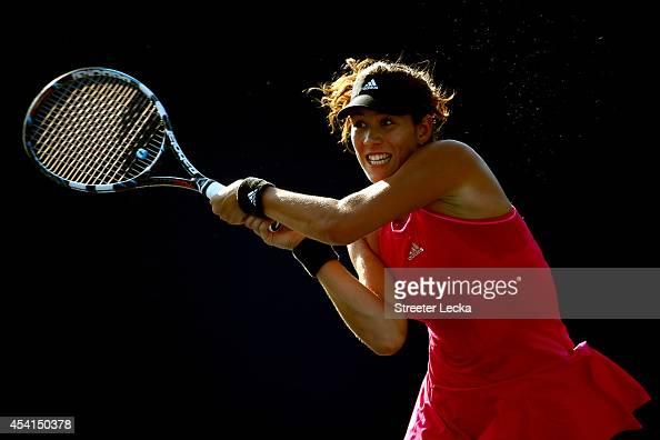 Garbine Muguruza of Spain returns a shot against Mirjana LucicBaroni of Croatia during her women's singles first round match on Day One of the 2014...
