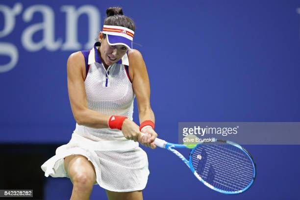 Garbine Muguruza of Spain returns a shot during her women's singles fourth round match against Petra Kvitova of Czech Republic on Day Seven of the...