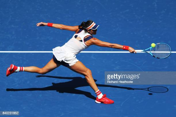 Garbine Muguruza of Spain returns a shot during the first round Women's Singles match against Varvara Lepchenko of the United States on Day One of...