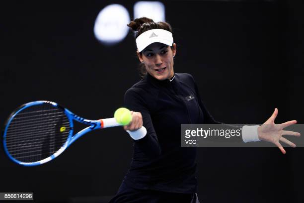 Garbine Muguruza of Spain returns a shot during the Women's singles first round match against Barbora Strycova of Czech Republic on day three of 2017...