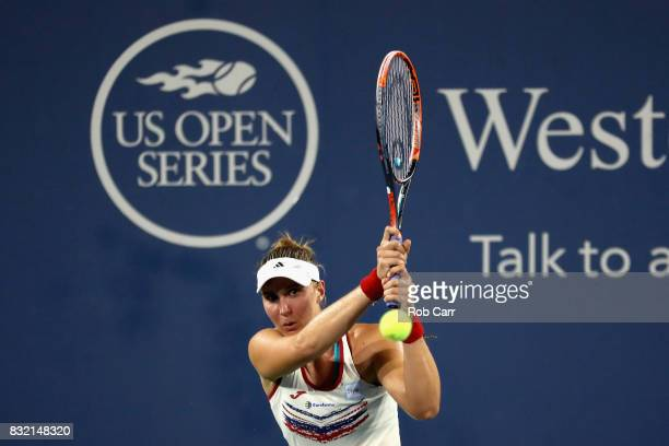 Garbine Muguruza of Spain returns a shot to Beatriz Haddad Maia of Brazil during the Western and Southern Open on August 15 2017 in Mason Ohio