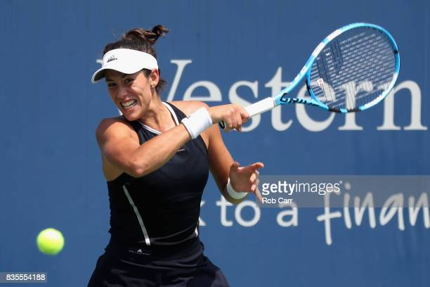Garbine Muguruza of Spain returns a shot to Karolina Pliskova of Czech Republic during Day 8 of the Western and Southern Open at the Linder Family...