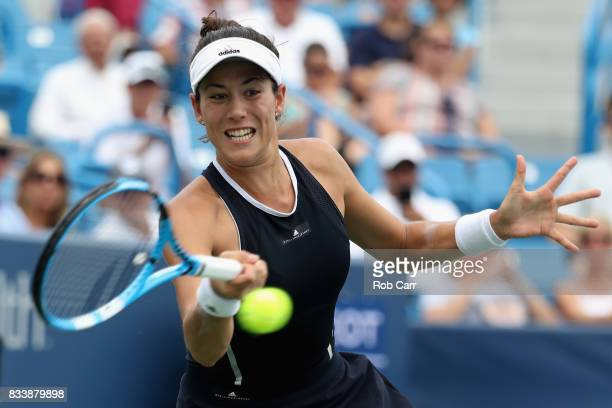 Garbine Muguruza of Spain returns a shot to Madison Keys during Day 6 of the Western and Southern Open at the Linder Family Tennis Center on August...