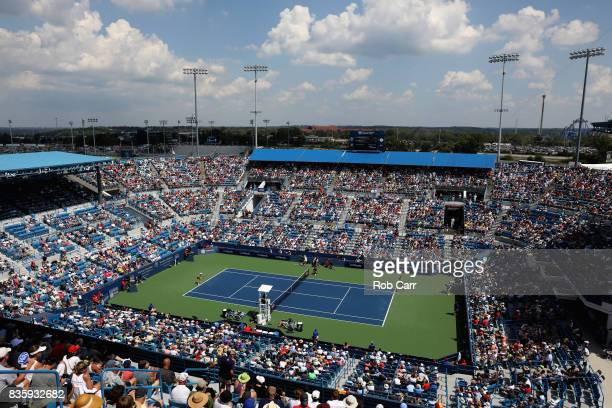 Garbine Muguruza of Spain returns a shot to Simona Halep of Romania during Day 9 of the women's final of the Western and Southern Open at the Linder...