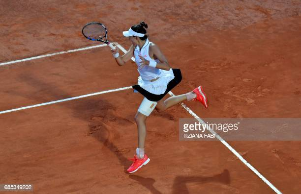 Garbine Muguruza of Spain returns the ball to Venus Williams of US during the WTA Tennis Open tournament in Rome at the Foro Italico on May 19 2017 /...