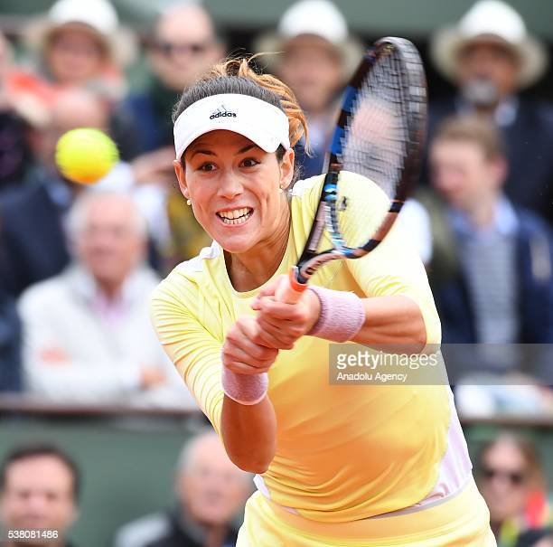 Garbine Muguruza of Spain returns to Serena Williams of the USA during women's single final match at the French Open tennis tournament at Roland...