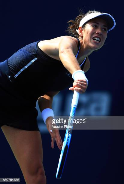 Garbine Muguruza of Spain serves against Elina Svitolina of Ukraine during a quarterfinal match on Day 8 of the Rogers Cup at Aviva Centre on August...