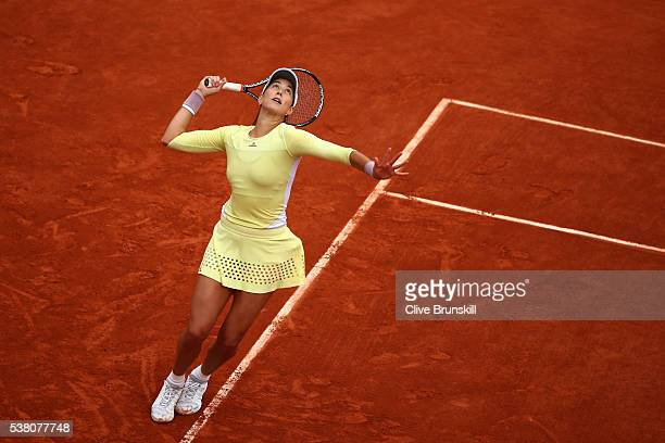 Garbine Muguruza of Spain serves during the Ladies Singles final match against Serena Williams of the United States on day fourteen of the 2016...