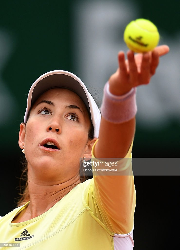 Garbine Muguruzu of Spain serves during the Ladies Singles fourth round match against Svetlana Kuznetsova of Russia on day eight of the 2016 French Open at Roland Garros on May 29, 2016 in Paris, France.